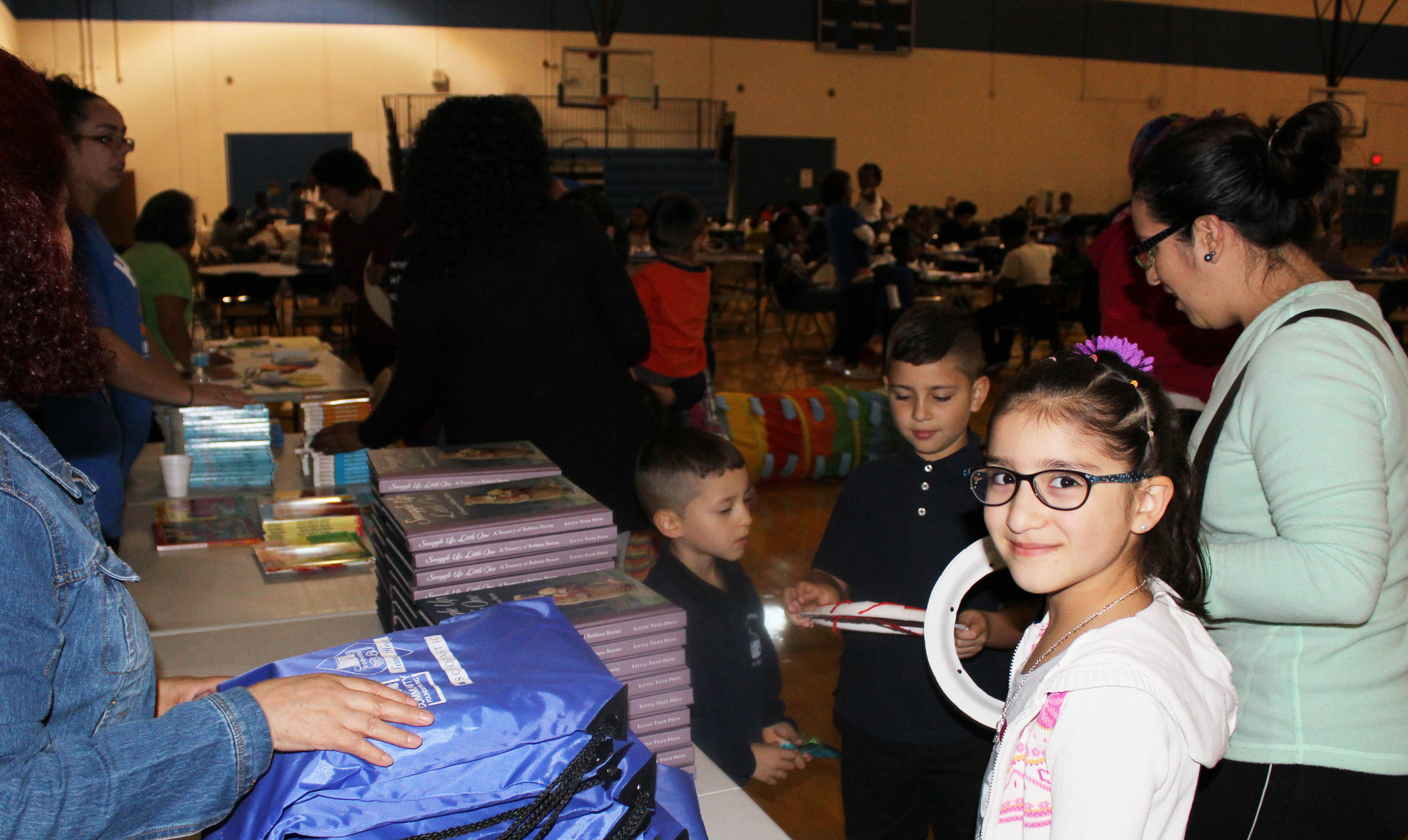 Grateful families receiving backpacks stuffed with great books!